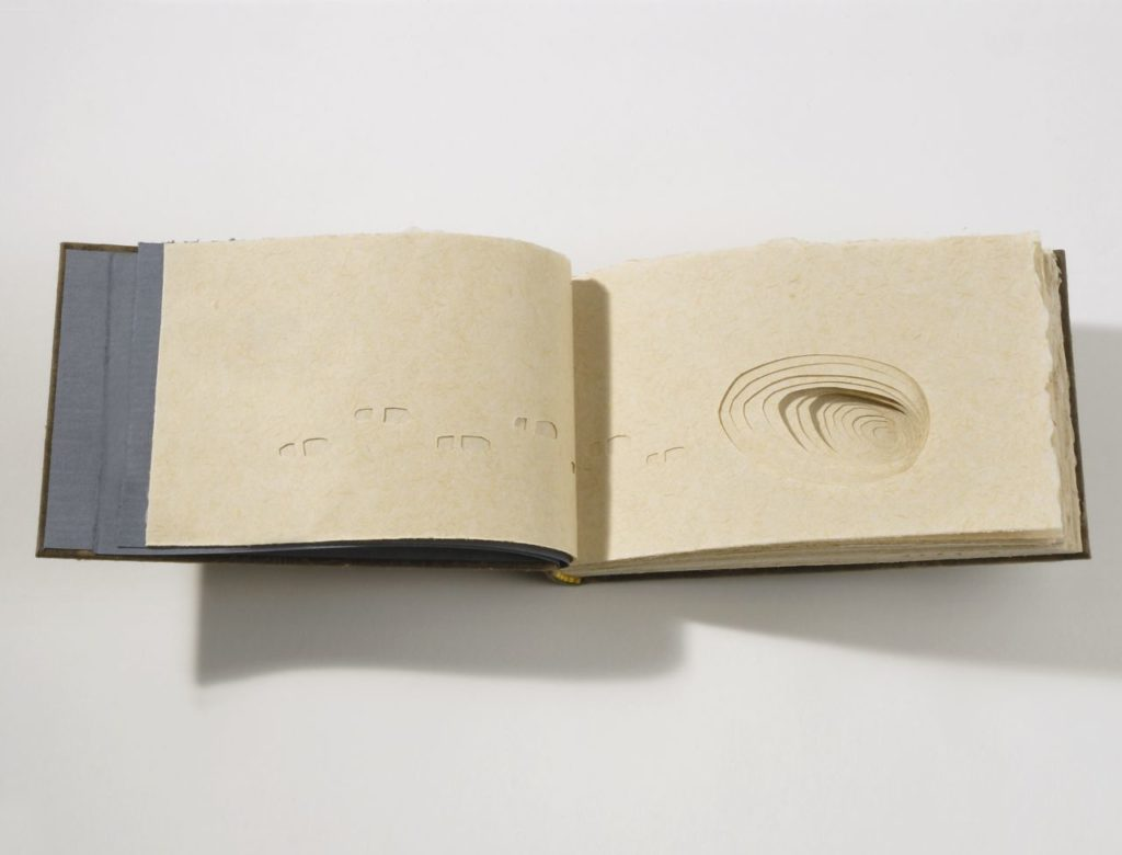 """I'd like a home (2007). Handmade abaca and milkweed paper, papercuts and pen, 72 pages. 4.25 x 7 x 1"""". Oberlin College Art Library Collection."""