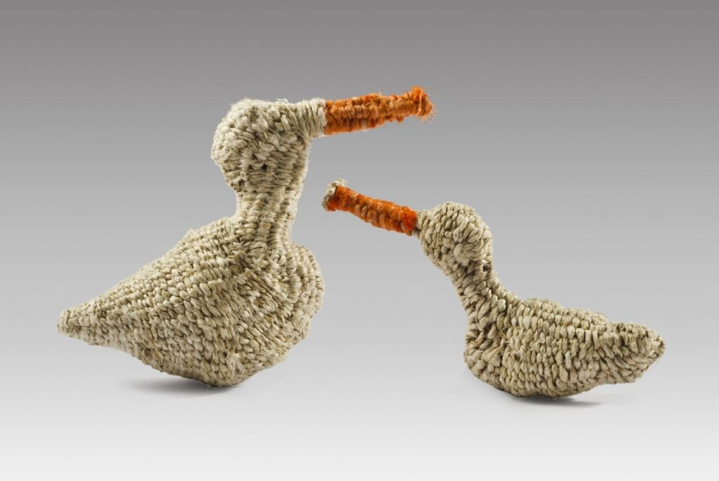 """Kozo ducks (2015). Persimmon and fiber reactive dyes on twisted and twined paper mulberry bark. 2.25"""" high, 3.5"""" long and 2"""" high, 3.25"""" long. Private collection."""