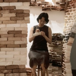 Performance: Drawing Comics About Guests As Gifts On Loose Bricks