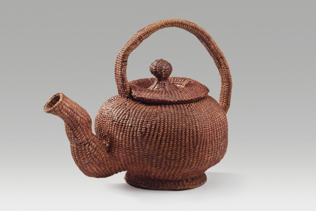"Footed teapot (2016). Corded and twined hanji, persimmon juice. 6.75 x 8.25 x 5""."