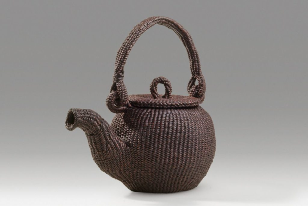 "Teapot (2014). Lacquer on hanji. 7.25"" tall, 7"" across spout, 3"" base diameter."