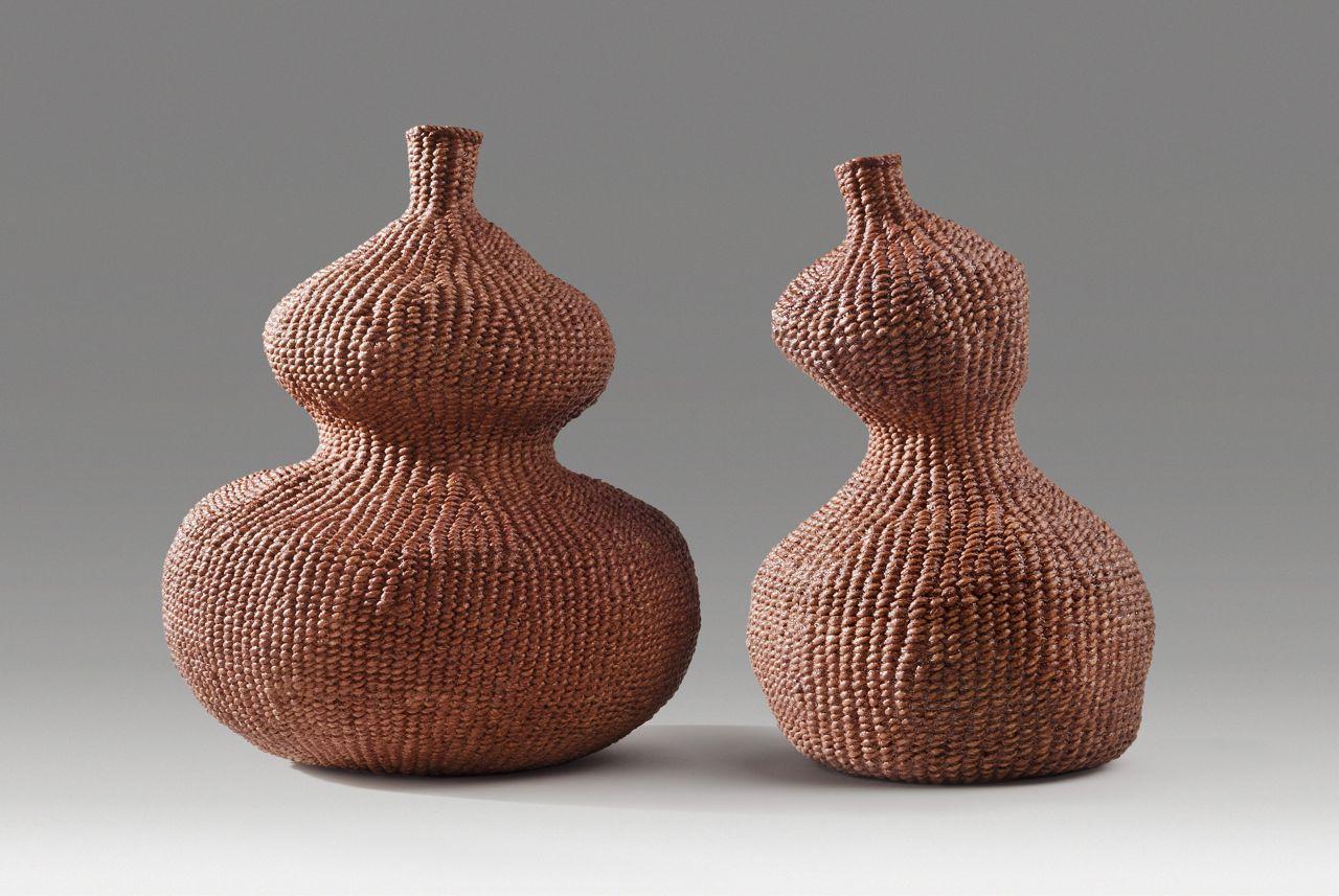 "Paired gourds (2014). Persimmon dye on hanji. 7"" high, 6"" wide; 6.5"" high, 3.5"" base diameter. Private collection."