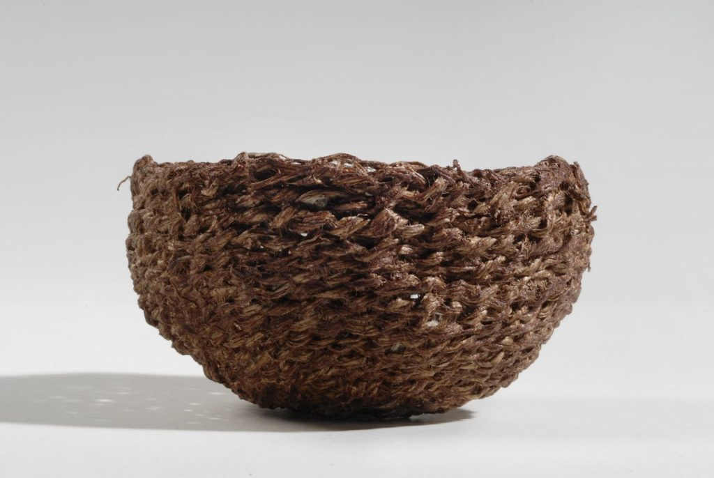 "Bark basket (2010). Persimmon juice on mulberry bark. 3"" dia, 2"" high. Private collection."