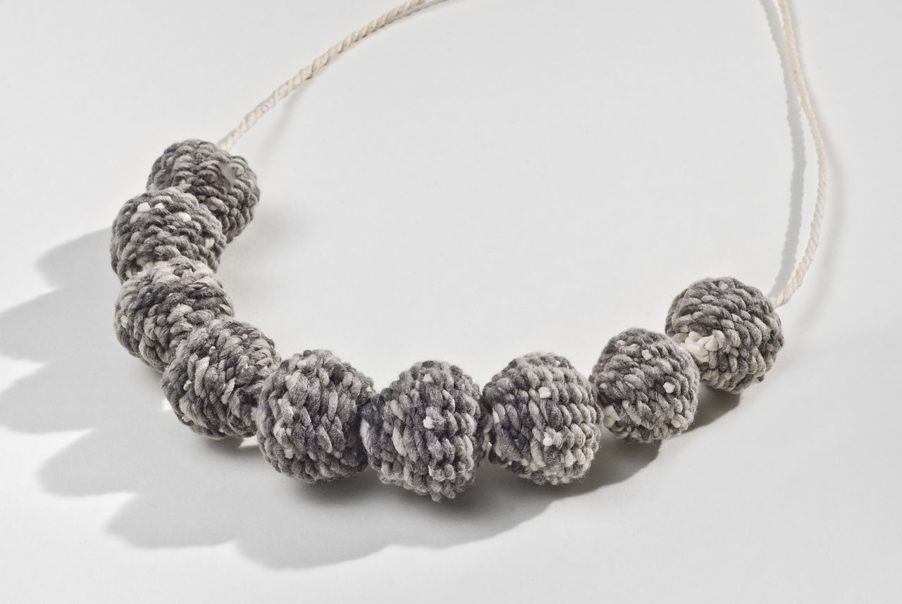 "Grey bead necklace (2012). Hanji, calligraphy ink (9 beads). 1.2"" diameter each. Private collection."
