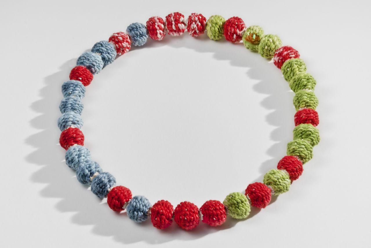 "Tri-color bead necklace (2013). Hanji, washi (35 beads). 0.8"" diameter each."
