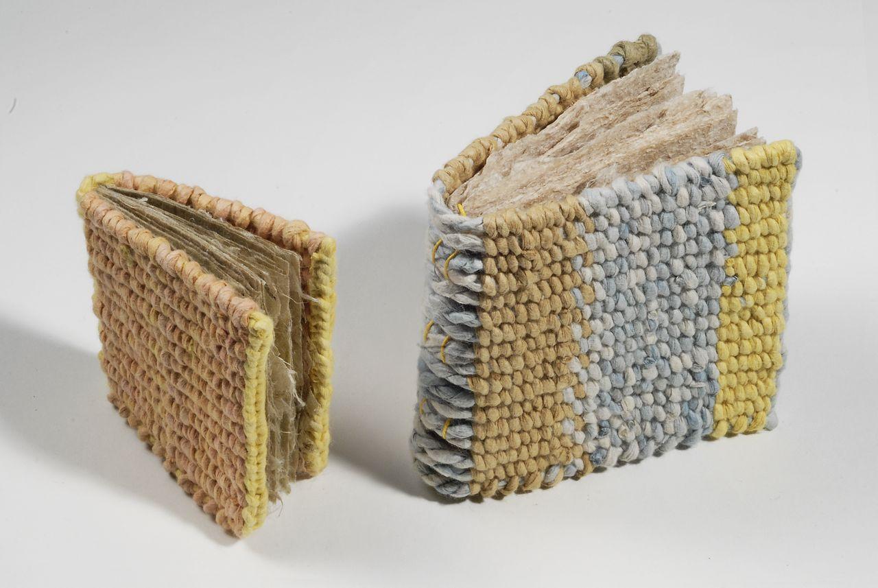 "Woven Books (2010). Hanji, dye, thread. 2.75 x 2.5 x 0.5"" and 3.5 x 3.5 x 1.25""."