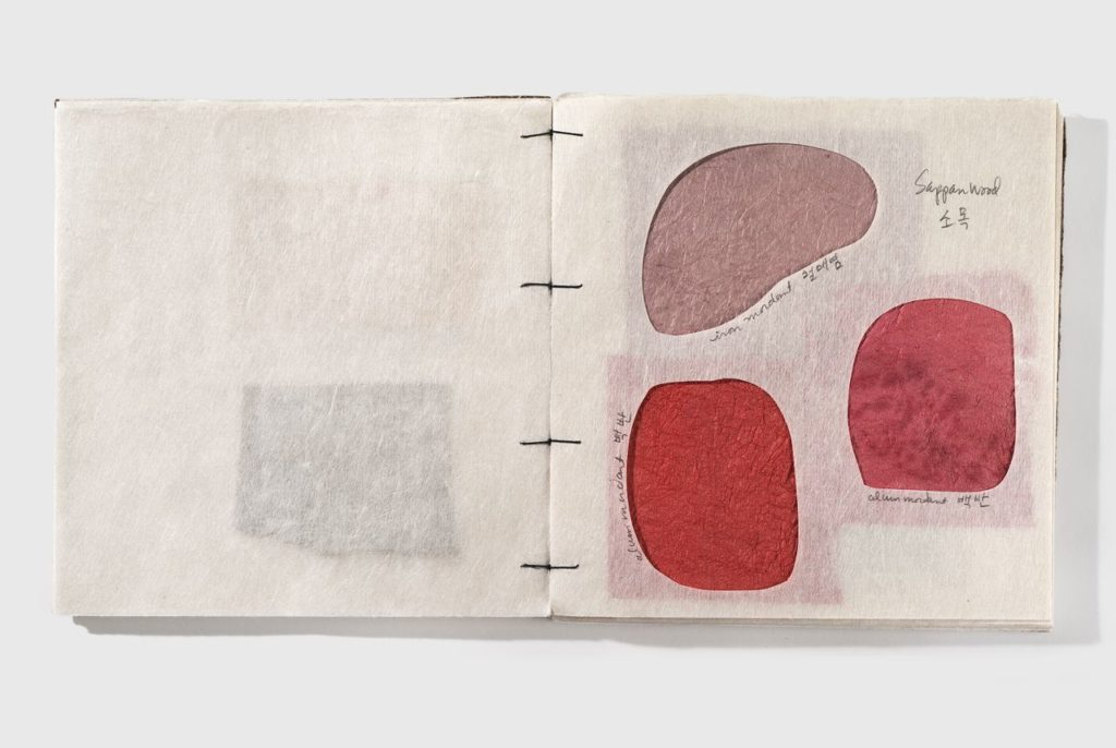 "Hanji sample book (2009). Hanji, dyes, lacquer. 8.5 x 8.25 x 0.8""."