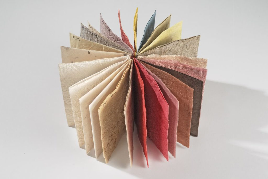 "Hanji sample book (2009). Hanji, dyes, thread. 5 x 4 x 1.25""."