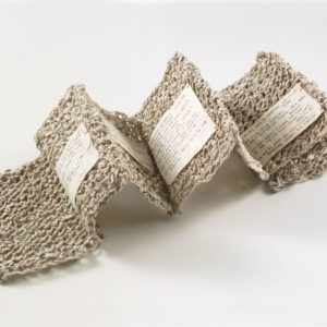 """Knit Sestina (2006). Handmade Mulberry Paper, Typed Poem, Thread. 5.5 X 4.25 X 2"""". Collection Of Kohler Art Library, UW Madison."""