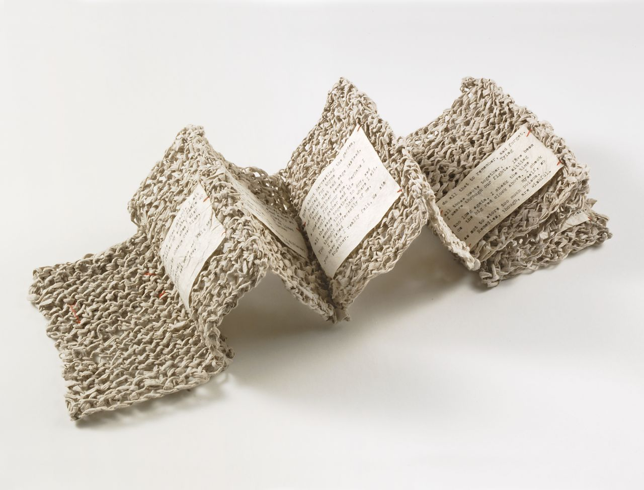 "Knit Sestina (2006). Handmade mulberry paper, typed poem, thread. 5.5 x 4.25 x 2"". Collection of Kohler Art Library, UW Madison."