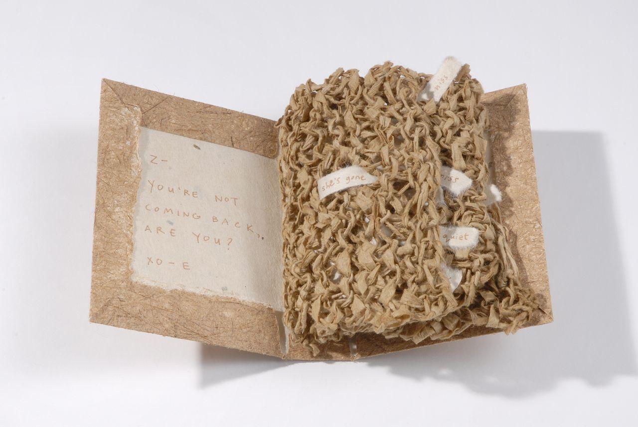 """Chapter Fourteen (2009). Spun and knit hanji, pen on hanji, cover of handmade cattail/hemp paper, 4.5 x 3.25 x 1.25"""". Oberlin College Art Library Collection."""