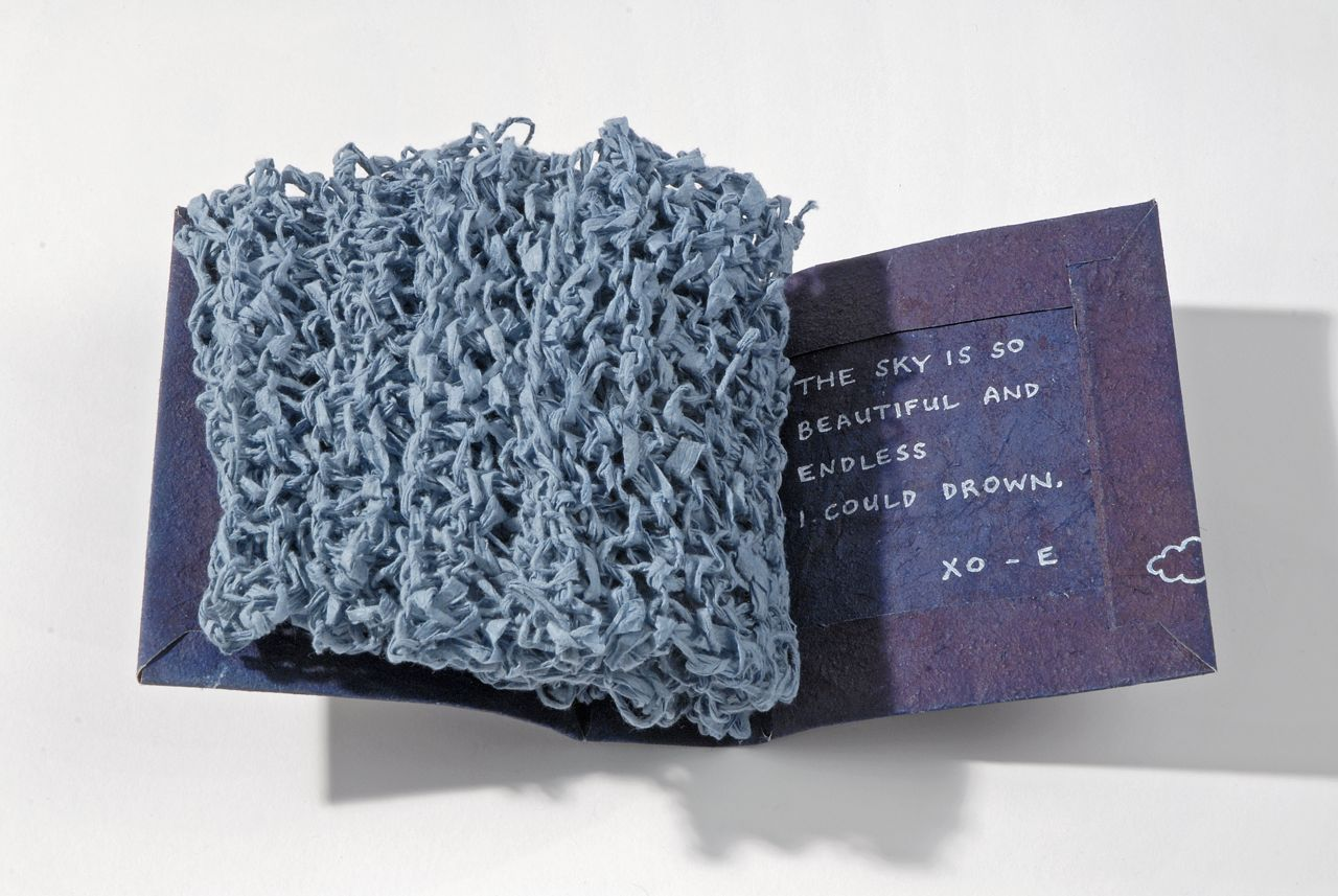 "Chapter Sixteen (2009). Spun and knit hanji, pen on indigo-dyed handmade cotton/hemp/cattail paper. 4.75 x 4 x 2"". U of Denver Penrose Library Collection."