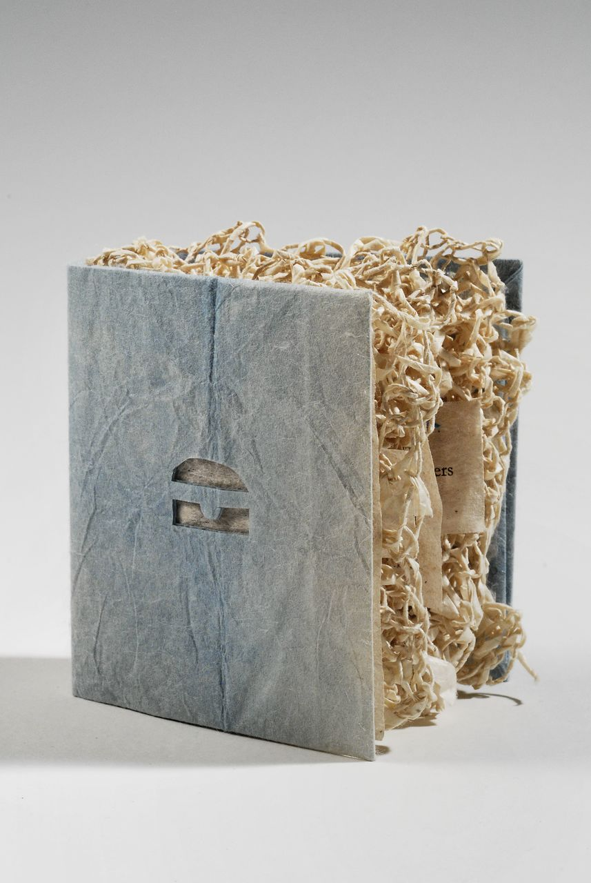 "Paper (2010). Inkjet print on hanji, lokta, indigo, thread, poem by Joana Varawa. 3.25 x 2.75 x 1.25"". Yale Haas Library Collection."