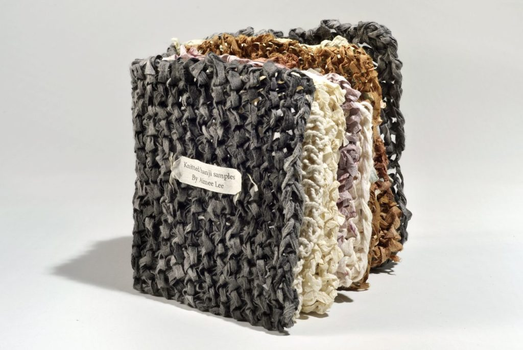 "Knitted hanji samples (2011). Varied knitted hanji with natural dyes, coatings, and techniques. 5 x 4.5 x 3"" closed. Artist collection."