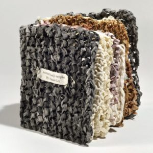 """Knitted Hanji Samples (2011). Varied Knitted Hanji With Natural Dyes, Coatings, And Techniques. 5 X 4.5 X 3"""" Closed. Artist Collection."""