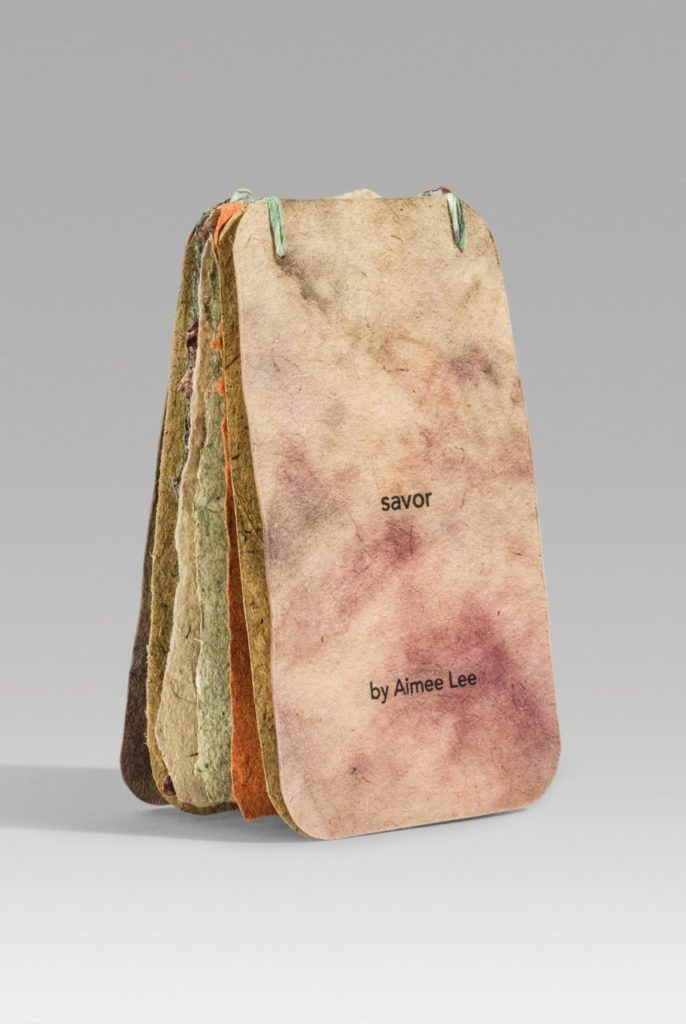 """Savor (2018). Inkjet print, ink, and marker on handmade papers and paper thread. 3.75 x 2.25 x 0.5"""" closed, 7.6"""" tall open. 8 leaves, first edition of 2. Collections of Bainbridge Island Museum of Art, Baylor University."""