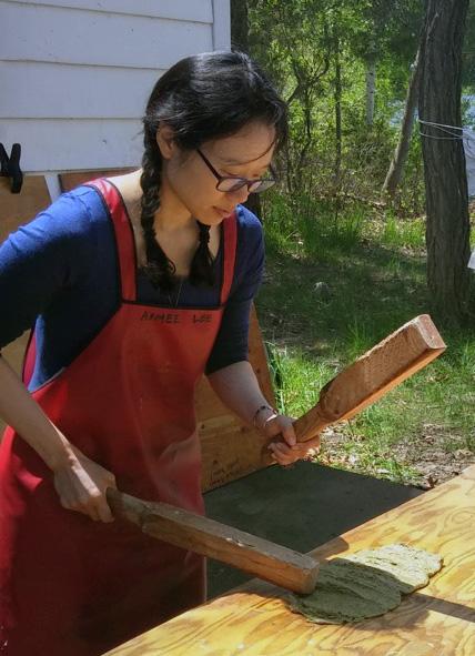 Aimee beats bast fiber by hand