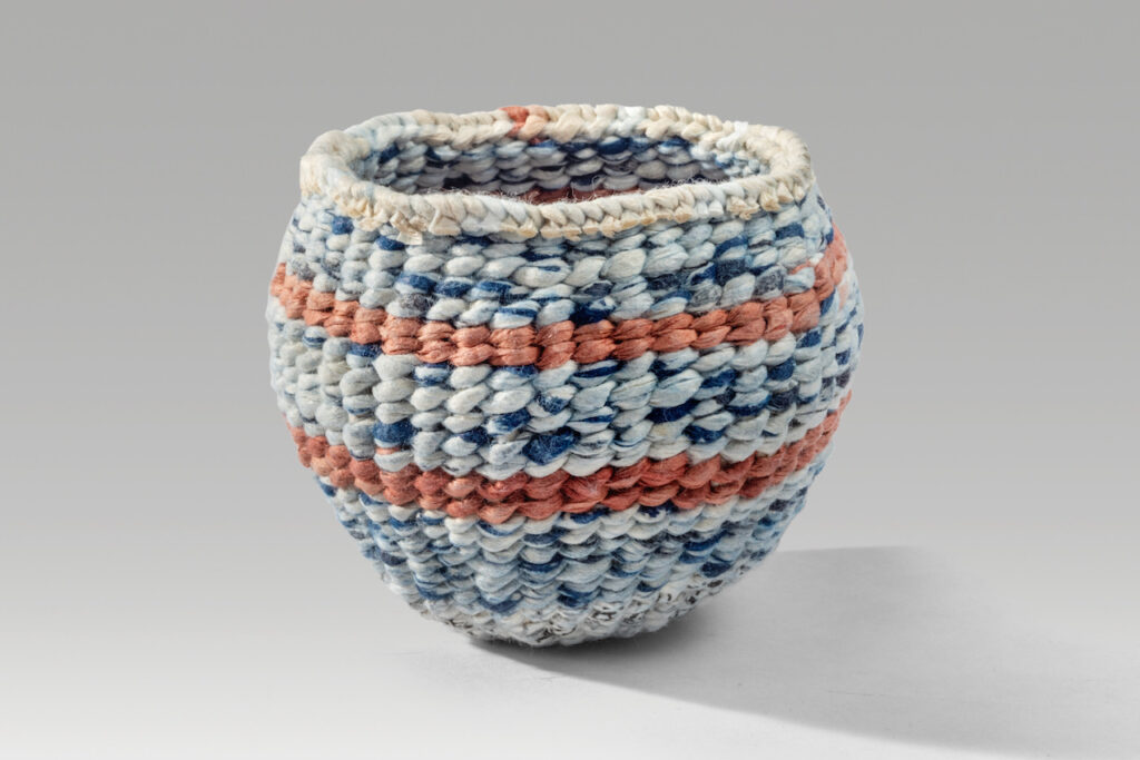 """Waxed vessel (2020). Natural dyes and beeswax on corded and twined hanji. 2.5 x 2.75 x 2.75""""."""